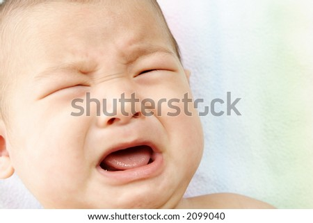 A closeup portrait of a crying baby