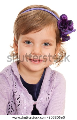 A closeup portrait of a curious little girl; isolated on the white background