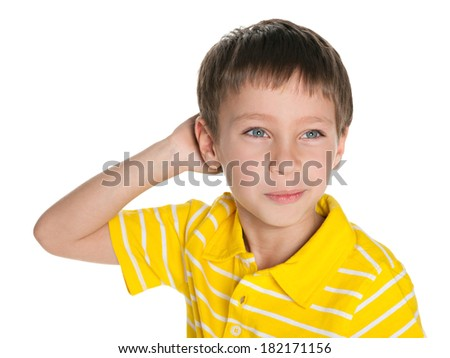 A closeup portrait of a dreaming little boy on the white background - stock photo