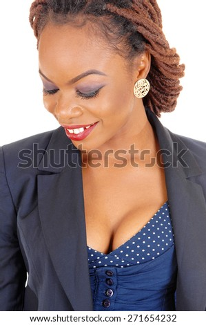 A closeup portrait of a pretty African American women in a dark blue jacket and braided hair standing isolated for white background.  - stock photo