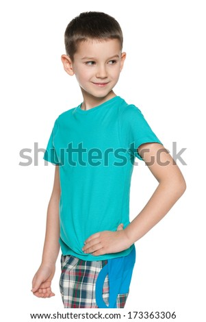 A closeup portrait of a thoughtful young boy in blue shirt on the white background - stock photo