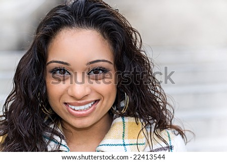 A closeup portrait of an attractive young Indian woman. - stock photo