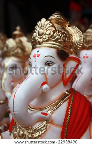 A closeup portrait of the face of Lord Ganesha Idol for sale on the eve of Ganesh festival in India. - stock photo
