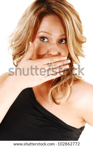 A closeup shoot of a very surprised blond woman, holding her hand for her mouth, looking upset, for white background. - stock photo