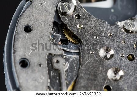 A closeup shot from a wrist watch clockwork. - stock photo