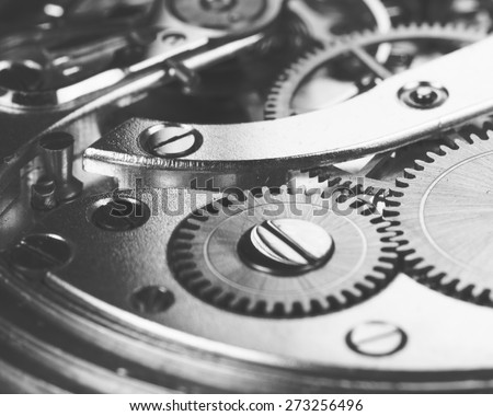 A closeup shot of a magnificent clockwork, image is in black and white. - stock photo