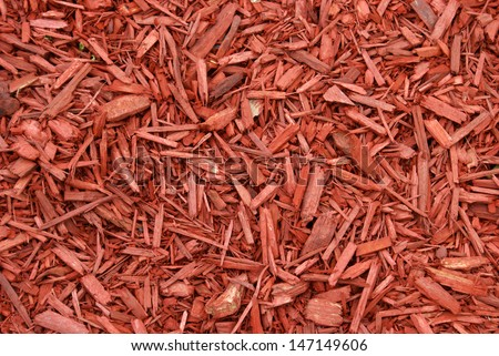 A closeup shot of red mulch used for garden decorating. - stock photo