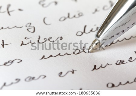 A closeup view from a handwritten document. - stock photo