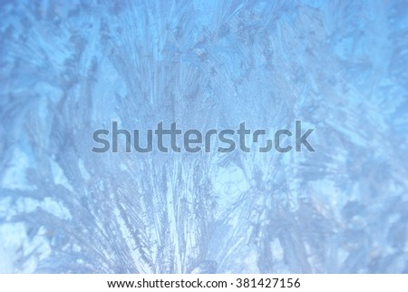 A closeup view of a frosted winter window. - stock photo