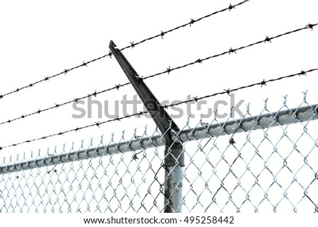 A closeup view of a security fence showing rows of barbed wire. Isolated on white.