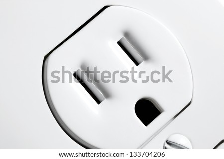 A closeup view of an North American electrical outlet. - stock photo