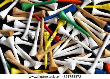 A closeup view of golf tees filling the image frame. - stock photo