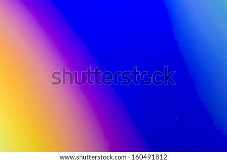 A closeup view of the rainbow reflection of light from a compact disk - stock photo