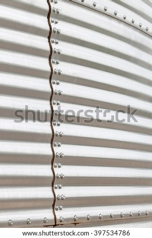 A closeup view of the seam on a corrugated metal granary for storing wheat and other cereal grains.  - stock photo
