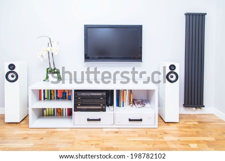 A closup of modern living room equipment with TV and stereo - stock photo