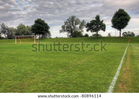 Cloudy unoccupied soccer field trees background stock photo 80896114 a cloudy unoccupied soccer field with trees in the background hdr photograph altavistaventures Gallery