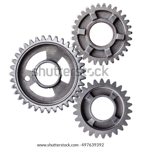 A cluster of interlocking metal gears isolated on a white background.
