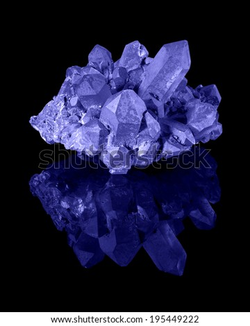 A cluster of well developed blue limonite quartz crystals with their reflection. - stock photo