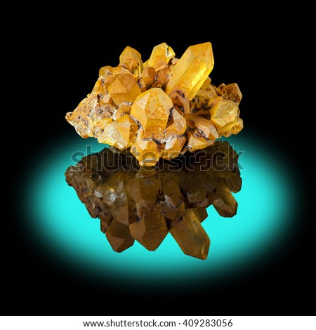 A cluster of well developed limonite quartz crystals with their reflection.
