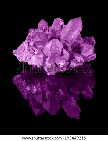 A cluster of well developed magenta limonite quartz crystals with their reflection. - stock photo