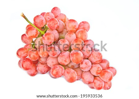 A cluster of wet red grapes on white background. - stock photo
