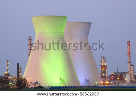 A coal power station and night blue sky - Oil Refineries - stock photo