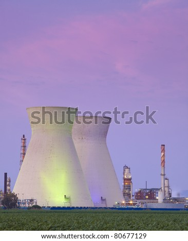 A coal power station and sunset - Oil Refineries - stock photo