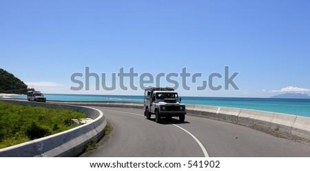 A coastal road at the caribbean island Antigua... - stock photo