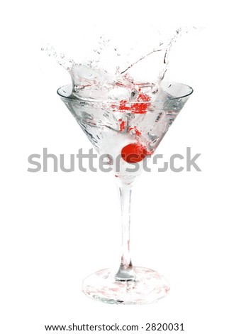 A cocktail drink with an cherry splash - stock photo