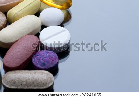 a cocktail of various tablets and pills, drugs and health supplements. - stock photo