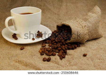 a coffee beans in bag and coffee mug - stock photo