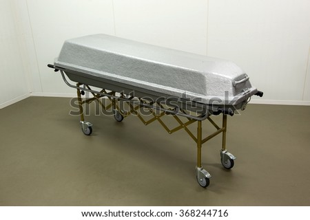 A coffin to transport a dead body in a morgue - stock photo