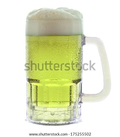 A cold frothy mug of green beer for St. Patricks Day isolated on white. - stock photo