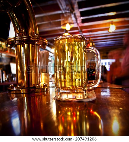 A cold pint of beer on a bar - stock photo