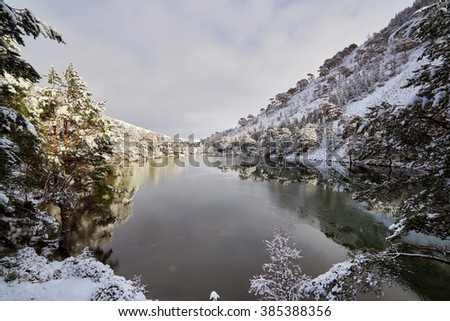 A cold snowy Loch Uaine, Glenmore Forest, Cairngorms in the Scottish Highlands, UK. - stock photo