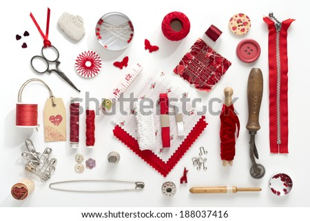 a collection needle work accessories in red on white background - stock photo