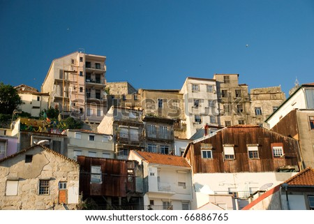 A collection of apartment buildings on the side of a hill in Porto, Portugal - stock photo