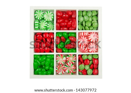 A collection of Christmas candies in a display box with nine compartments - stock photo