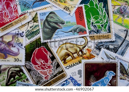 A collection of dinosaurs stamps from different countries, such as Congo, England, Romania, Bahrain and others - stock photo