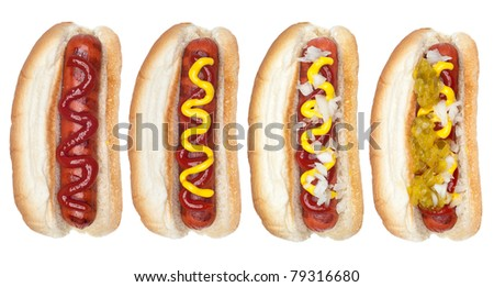 A collection of hotdogs with mustard, ketchup, relish and onions. - stock photo