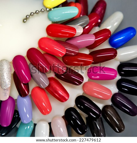 A collection of nail polish testers in various colors - stock photo