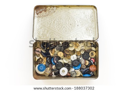 a collection of old buttons in a tin box, isolated - stock photo