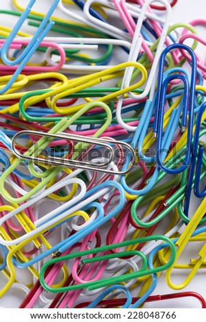 a collection of paperclips on a white surface - stock photo