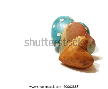 A collection of three hearts on white - stock photo