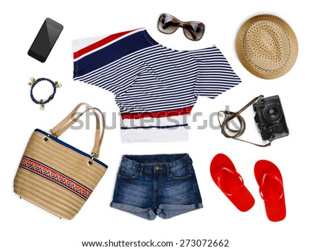 A collection of tourist clothes and accessories isolated on white - stock photo