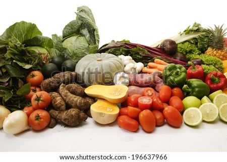 A collection of vegetables and fruits on an isolated white background - stock photo