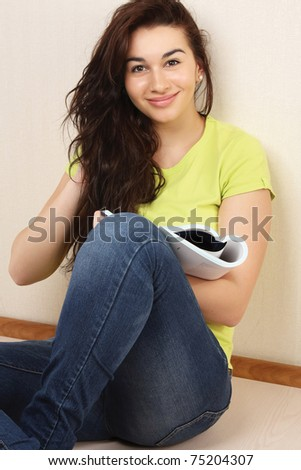 A college girl sitting with a book