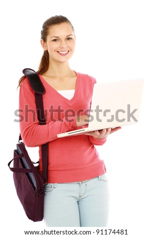 A college girl with bag holding a laptop,isolated on white background - stock photo