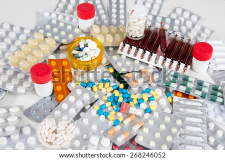 A color background made of colorful pills - stock photo