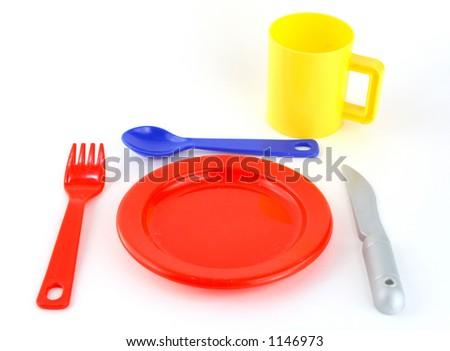 a colored set of cutlery with spoon, fork, knife, glass